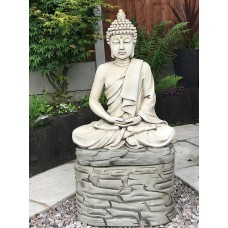 Praying Buddha On Rock